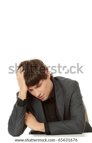 Businessman in depression, with hand on forehead. Isolated on white