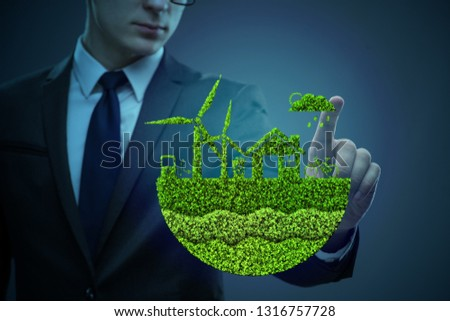 Businessman in ecological green concept #1316757728