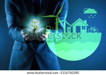 Businessman in ecological green concept #1316760380