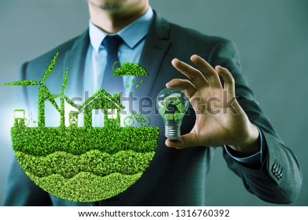 Businessman in ecological green concept #1316760392