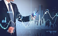Businessman in formal suit checking stock market rates in smartphone. Hologram charts. Business and financial success concept. Double exposure. Forex graph