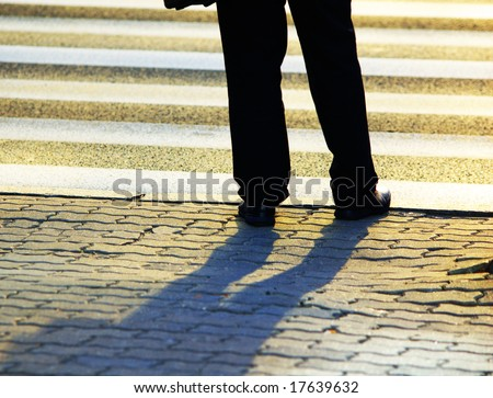 Businessman in front of pedestrian crossing
