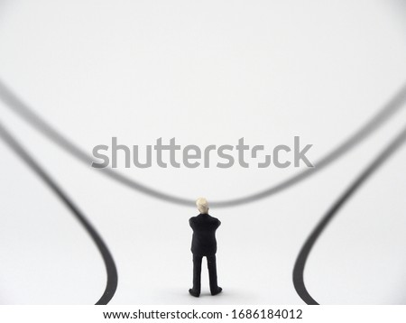 businessman in front of two roads/forked road,Someone who thinks important decisions ahead ストックフォト ©