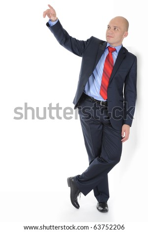 Businessman in full-length standing against a wall in a bright room. Isolated on white background