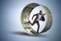 Businessman in hamster wheel chasing dollars
