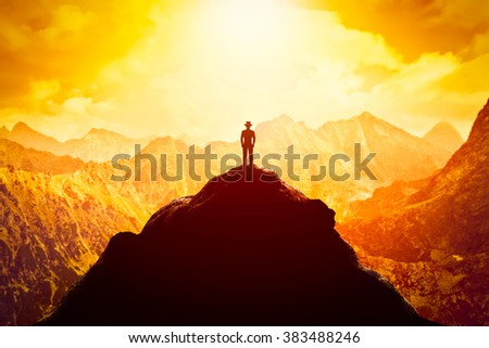 stock photo businessman in hat on the peak of the mountain looking at sunset conceptual business venture 383488246 - Каталог - 3d фотообои