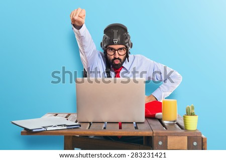 Businessman in his office with pilot hat over colorful background