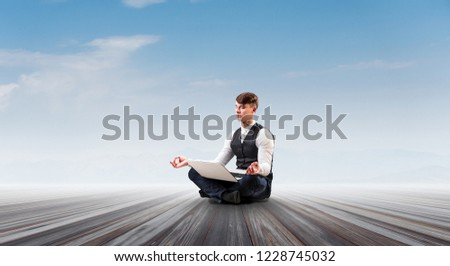 Businessman in lotus pose. Mixed media #1228745032