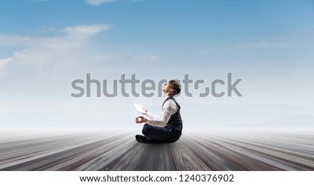 Businessman in lotus pose. Mixed media #1240376902
