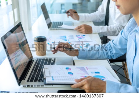 businessman in meeting analysis chart graphy marketing plan in business financial  audit project. Or Business adviser analyzing Budget. #1460137307
