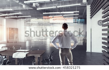 Businessman in modern office  . Mixed media #458321275