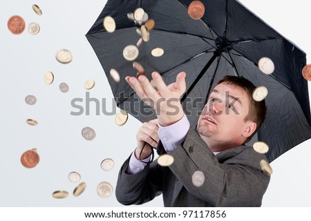 Businessman in money rain