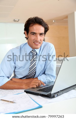 Businessman in office sitting at his desk