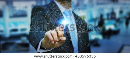 Businessman in office using digital data network #453596335
