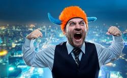 Businessman in party helmet shouting