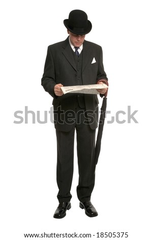 Businessman in pinstripe suit and traditional bowler hat with umbrella reading the financial newspaper