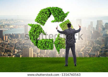 Businessman in recycling ecological concept #1316760563