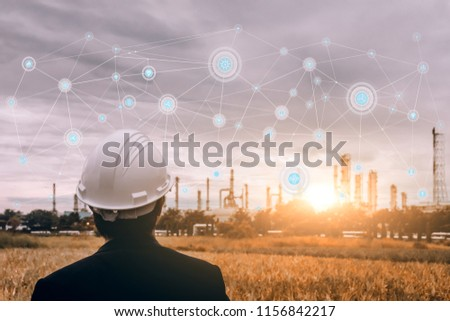 Businessman in safety helmet touching virtual interface screen as concept of industry 4.0  #1156842217