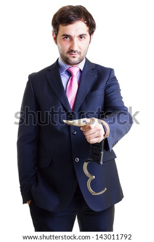Businessman in shackles paid a bribe white background. Conceptual image.