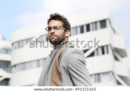 Businessman in spectacles and scarf #491151163