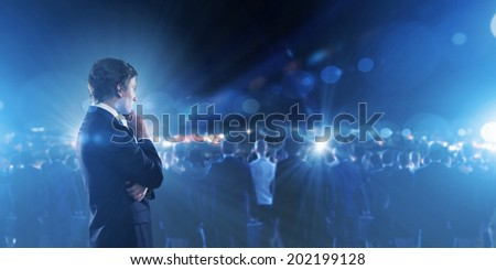 Businessman in suit against digital background with icons #202199128