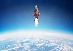 Businessman in suit and aviator hat flying on rocket in stratosphere. Superhero businessman flying with jetpack rocket in blue sky above clouds. Successful business startup. Career growth concept.