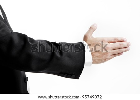 Businessman in suit giving an hand for handshake to seal the deal