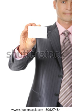 Businessman in suit handing a white blank. Isolated on white background