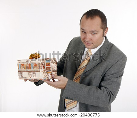businessman in suit holding present