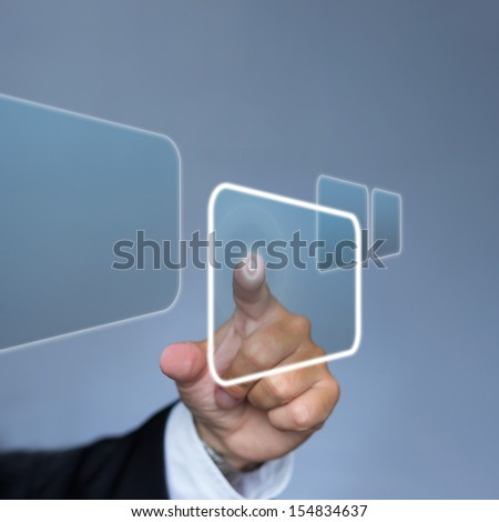Businessman in suit pushing the interface button in virtual reality