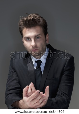 businessman in suit, shirt and tie, concerned, worried - isolated on gray - stock photo