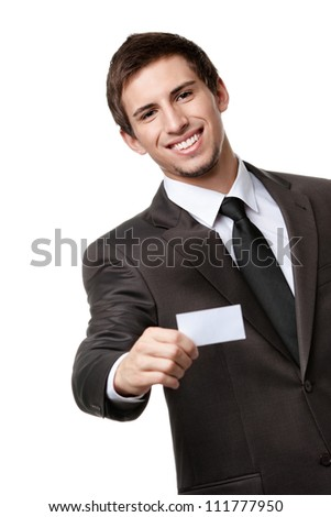 Businessman in suit showing his empty business card with copy space to write your own text, isolated on white