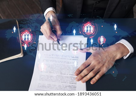 Businessman in suit signs contract. Double exposure with world map hologram. Man signing agreement international business concept. Stock foto ©