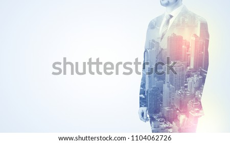 Businessman in suit standing thinking with metropolis graphic