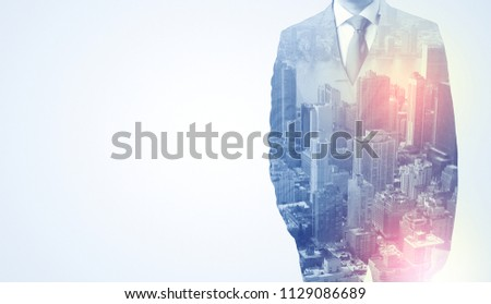 Businessman in suit standing thinking with metropolis graphic  #1129086689