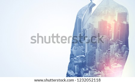 Businessman in suit standing thinking with metropolis graphic  #1232052118