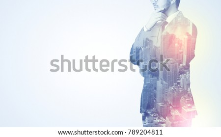 Businessman in suit standing thinking with metropolis graphic  #789204811