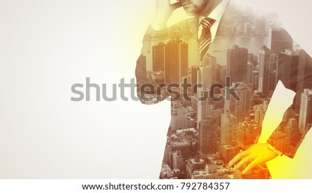 Businessman in suit standing thinking with metropolis graphic  #792784357