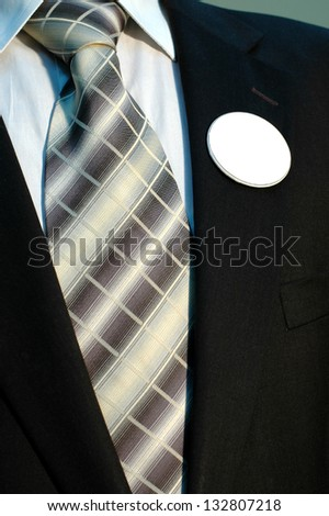 Businessman in Suit with blank badges