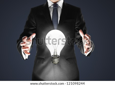 businessman in suit with lamp