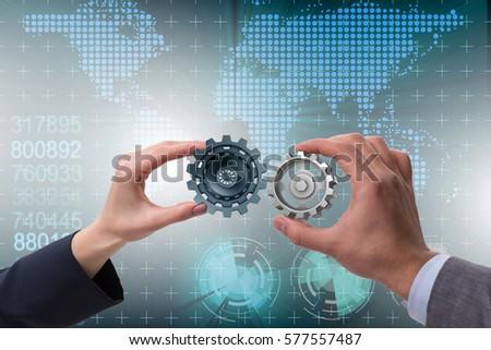 Businessman in teamwork concept with cogwheels #577557487