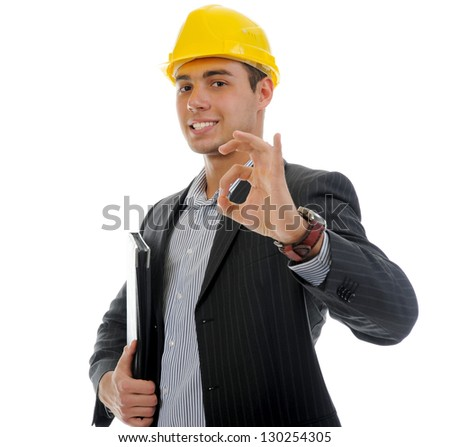 Businessman in the construction helmet with documents . Isolated on white background