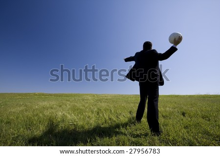 businessman in the field trowing a soccer ball