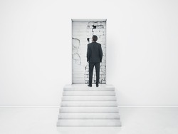 Businessman in the room with blocked doorway