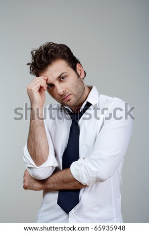 businessman in white shirt and tie, concerned, worried - isolated on gray