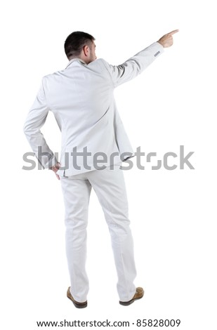 businessman in white suit pointing at wall. rear view. Isolated over white .