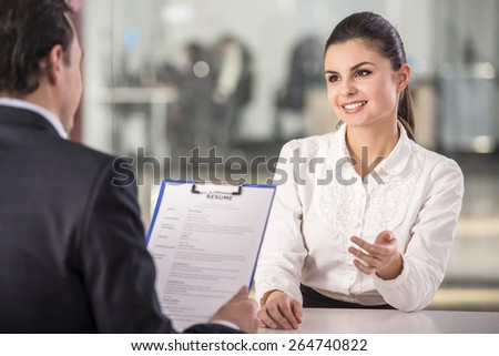 Businessman interviewing female candidate for job in office. Foto stock ©