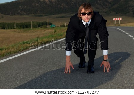 Businessman is at the start of running. Business struggle concept.
