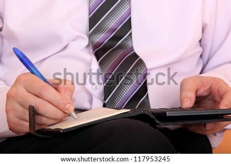 businessman is calculating closeup