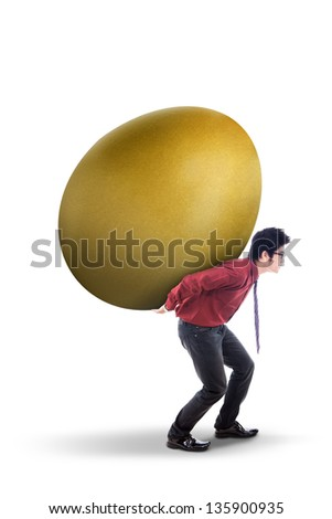 Businessman is carrying golden egg on his back, isolated on white